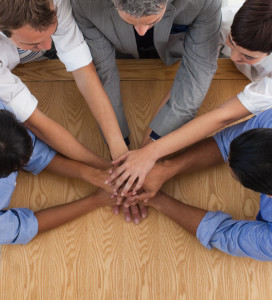Close-up of an International business team with hands together in a meeting